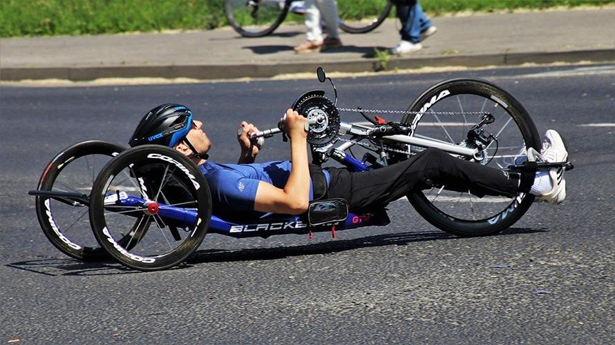 man on trike recumbent bike riding