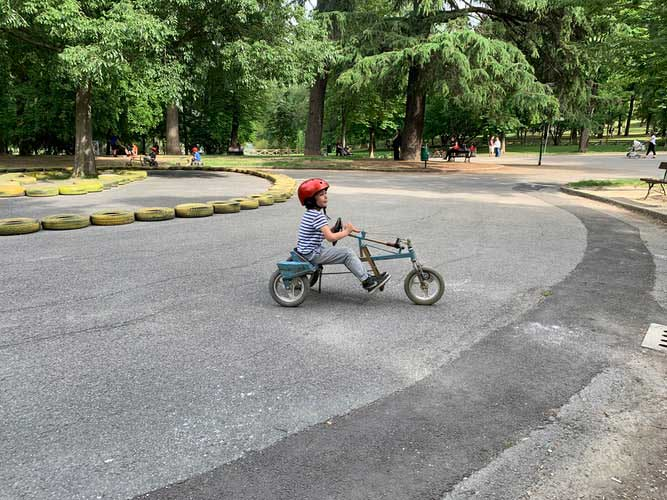 A kid is riding a Tricycle in Australia